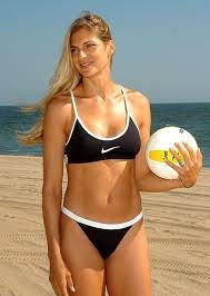 One of the beautiful people about to play volleyball on a beach - run!